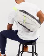 Nike Tech winterized bum bag in beige with neon zip